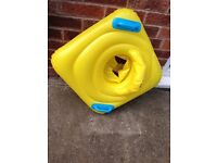 Baby inflatable round swimming seat from boots. Very good condition. Stress free to use