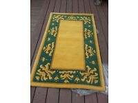 Rug 100 percent quality wool rug thick pile nice vibrant colours. Hand Made
