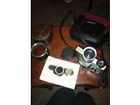 Minolta 110 SLR zoom camera with extended lens cap