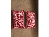 Two red and cream cushions