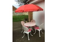 Garden set, consisting of Table, 4 chairs, seat pads and parasol