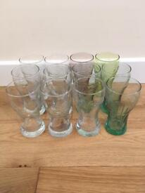 12 Coca Cola glasses. Various designs. Used but in great condition no chips etc. Great for a party.