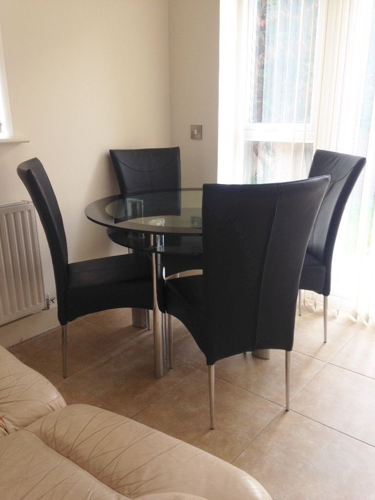 Gorgeous Glass Dining Table And Four Fantastic Chairs