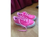 Pink Nike Air Force trainers