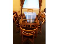 Cane dining table,6 chairs. 2 armchairs and display shelves. Excellent condition. Move forces sale