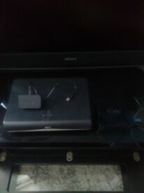 Sky box,modem and wi-fi booster.remote and leads