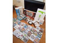 """Nintendo Wii, Wii Fit, Guitar Hero, 25 games (incl 8 Lego) many accessories AND A FREE 32"""" LCD TV!"""