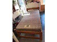 Pine single bed frame with spotless clean slumberland mattress
