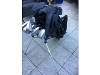 Half set child's golf clubs with extras