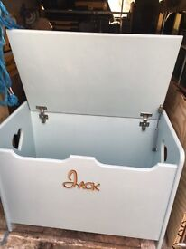 Handmade wooden toyboxes with the name of our choice on the front, soft closing lid, shaped handles