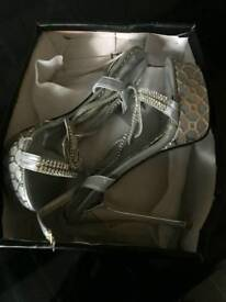 New never worn silver high heels size 5