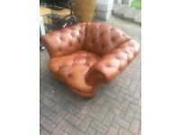 A leather chesterfield style armchair