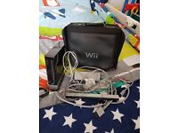 Nintendo wii console and wii fit