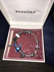 Genuine Pandora bracelet with charms