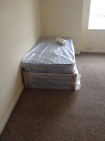 Brand new single divan bed and mattress still in the wrapper BRAND NEW