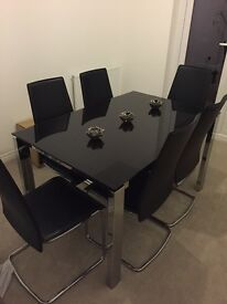 Calligaris black glass dining table with chrome legs