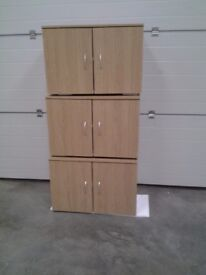 New Oak colour wall units / cupboards. Sold individually and whole. Bargain. Ideal utility etc.