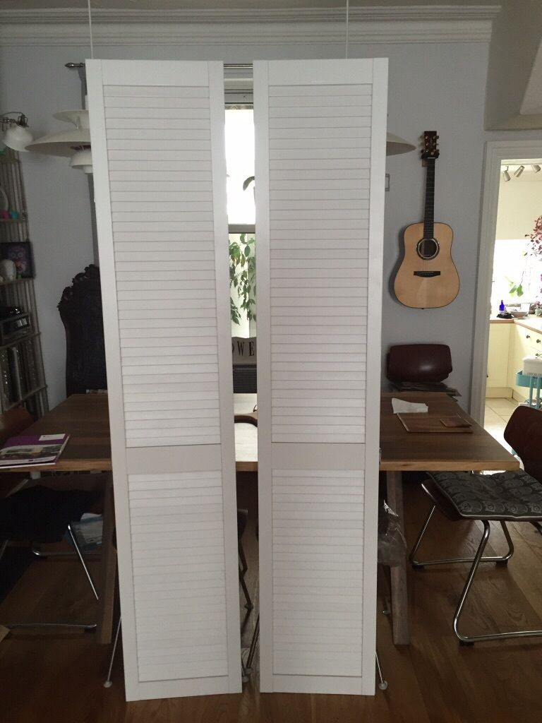 pair of tall slatted cupboard doors for airing cupboard or