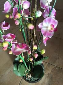 Artificial pink flower in pot