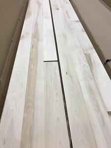 Unfinished hardwood flooring. Maple or red oak.
