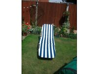 Sun lounger ble and white striped.