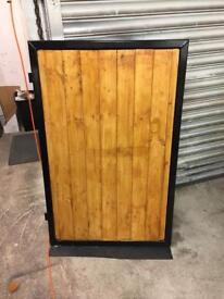 Wooden infill wrought iron gate