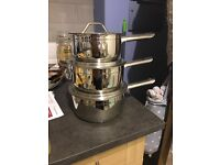 Brand new set of stainless steel saucepans