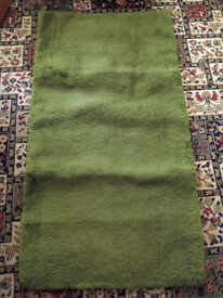 Soft green rug
