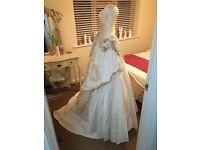 *Designer wedding dress by Ian Stuart*