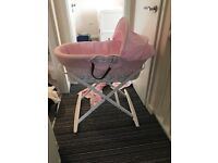 Pink Moses basket with rockin stand