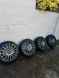 15 inch alloys with new tyres