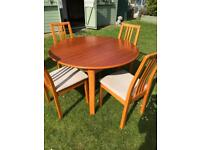 Modern extending dining table with four chairs (can deliver)