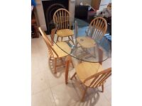 Oval Glass Table with 4 wooden chairs