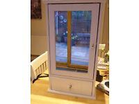 White wooden bathroom cabinet with mirrored door