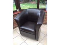 Faux leather tub chair. Seldom used, Excellent condition. Dark brown.