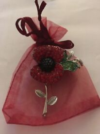 Gift in a bag. A beautiful poppy brooch to give to someone you care for Or maybe keep for yourself