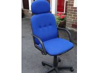 Office chair in royal blue fabric on castors.