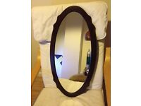Lovely mirror with brown wood frame