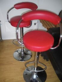 A COUPLE OF RED GAS-LIFT HEIGHT ADJUSTABLE ZENITH BAR STOOLS FOR REFURBISHMENT COLLECTION ONLY