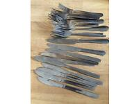 Forks and knives and food plates