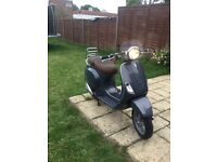 Hardly used Vespa LXV 125