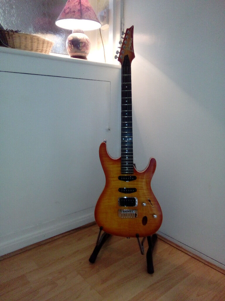 Ibanez guitarin Bolton, ManchesterGumtree - Ibanez sa series guitar good condition,beautiful blend of woods,with tiger wood front panel.Superb Ibanez slim neck,trim inset of neck retaining screws,pleasure to hold and play.Plush lined hard case included.No offers please