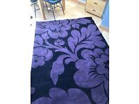 Large black and purple rug