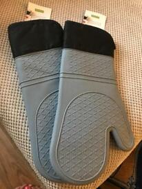 Two brand new grey and black silicone oven gloves