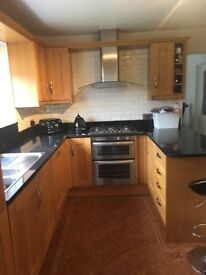 Solid oak wood fitted kitchen with black granite work tops