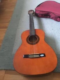 Wooden Guitar with a Case for it