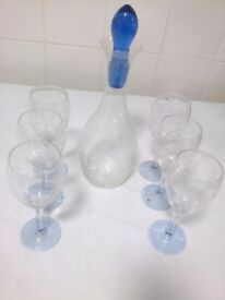 6 wine glasses and decanter with blue stopper