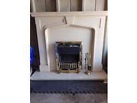 cream marble fire place and elecyric fire