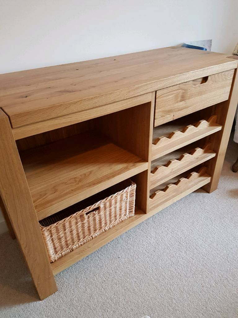 Solid oak sideboardin Melksham, WiltshireGumtree - Beautiful Solid Oak sideboard. Includes basket and can hold 15 bottles. A bargain as bought for £1000 . Cash on Collection. Please message for more details. Thanks
