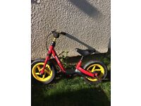 "Balance bike from Kettler. Runs smoothly. In a good condition. 12"" frame in a nice red colour."